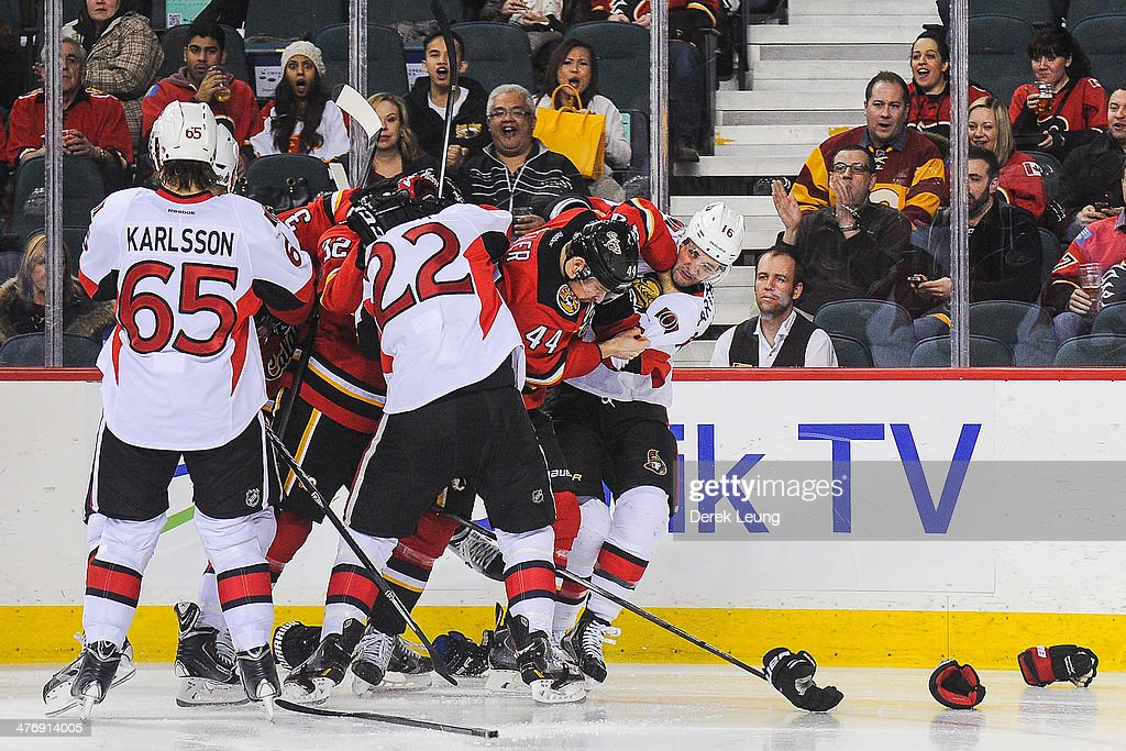 <a gi-track='captionPersonalityLinkClicked' href=/galleries/search?phrase=Paul+Byron+-+Ice+Hockey+Player&family=editorial&specificpeople=4535697 ng-click='$event.stopPropagation()'>Paul Byron</a> #32 and Chris Butler #44 of the Calgary Flames fight <a gi-track='captionPersonalityLinkClicked' href=/galleries/search?phrase=Erik+Condra&family=editorial&specificpeople=6254234 ng-click='$event.stopPropagation()'>Erik Condra</a> #22 and <a gi-track='captionPersonalityLinkClicked' href=/galleries/search?phrase=Clarke+MacArthur&family=editorial&specificpeople=3949382 ng-click='$event.stopPropagation()'>Clarke MacArthur</a> #16 of the Ottawa Senators during an NHL game at Scotiabank Saddledome on March 5, 2014 in Calgary, Alberta, Canada. The Flames defeated the Senators 4-1.