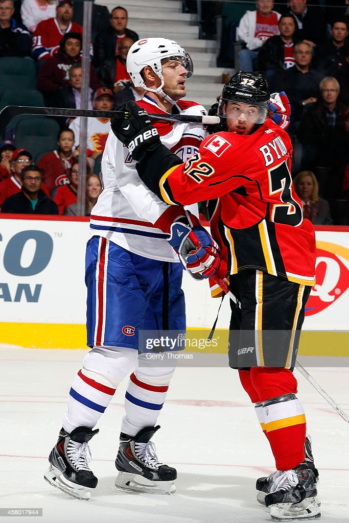 Paul Byron #32 of the Calgary Flames skates against Andrei Markov #79 of the Montreal Canadiens at Scotiabank Saddledome on October 28, 2014 in Calgary, Alberta, Canada.