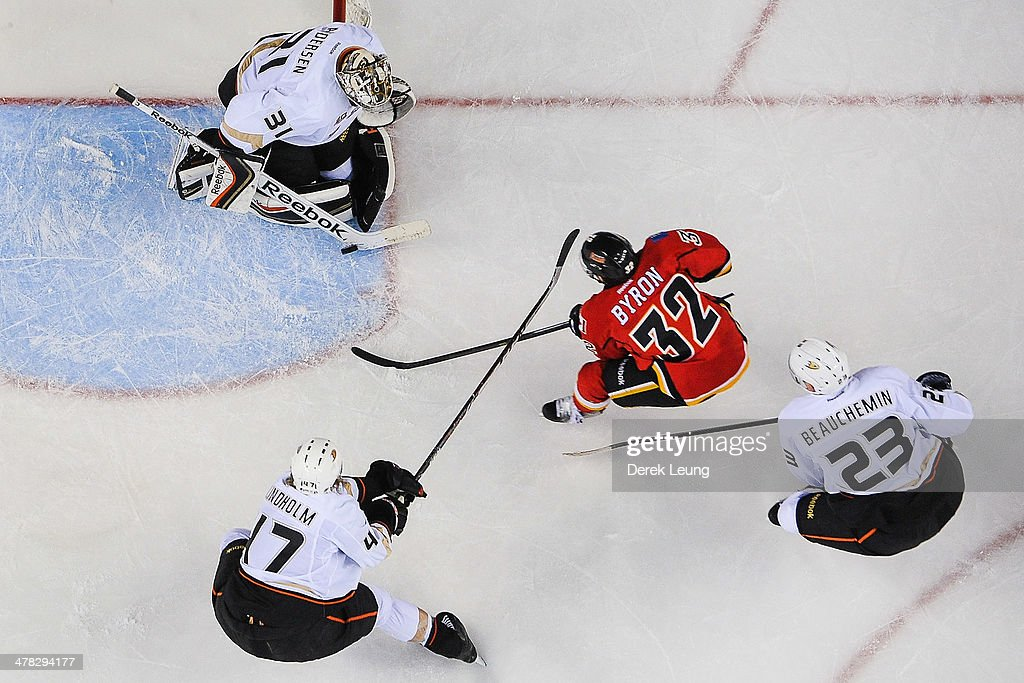 <a gi-track='captionPersonalityLinkClicked' href=/galleries/search?phrase=Paul+Byron+-+Ice+Hockey+Player&family=editorial&specificpeople=4535697 ng-click='$event.stopPropagation()'>Paul Byron</a> #32 of the Calgary Flames takes a shot on <a gi-track='captionPersonalityLinkClicked' href=/galleries/search?phrase=Frederik+Andersen&family=editorial&specificpeople=6605243 ng-click='$event.stopPropagation()'>Frederik Andersen</a> #31 of the Anaheim Ducks during an NHL game at Scotiabank Saddledome on March 12, 2014 in Calgary, Alberta, Canada. The Flames defeated the Ducks 7-2.