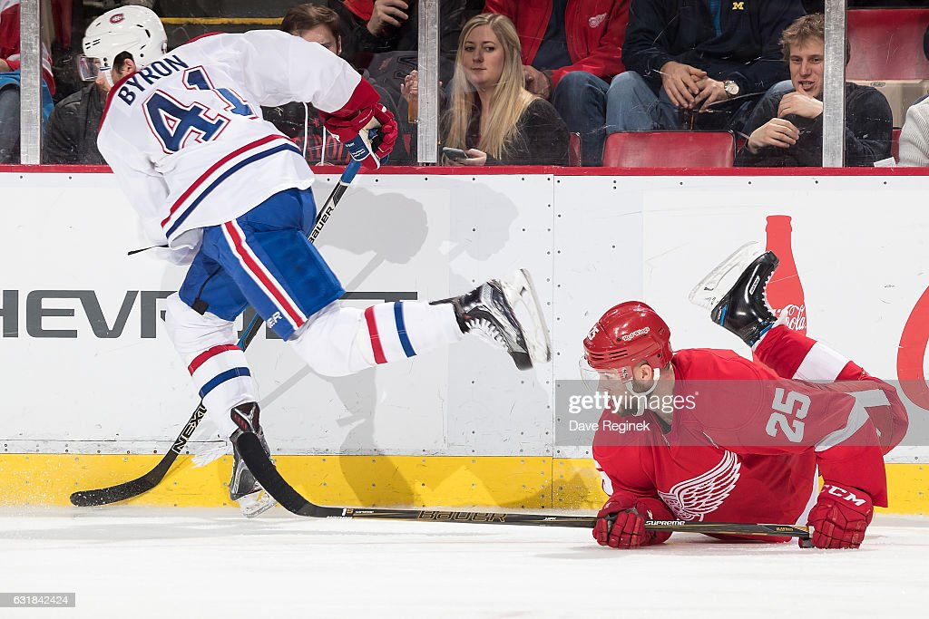 Paul Byron #41 of the Montreal Canadiens battles along the boards with Mike Green #25 of the Detroit Red Wings during an NHL game at Joe Louis Arena on January 16, 2017 in Detroit, Michigan. The Wings defeated the Canadiens 1-0.