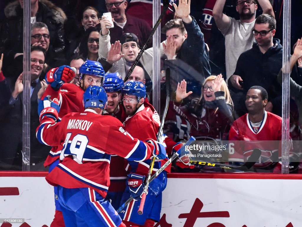 Paul Byron #41 of the Montreal Canadiens celebrates a goal late in the third period with teammates during the NHL game against the Nashville Predators at the Bell Centre on March 2, 2017 in Montreal, Quebec, Canada. The Montreal Canadiens defeated the Nashville Predators 2-1.