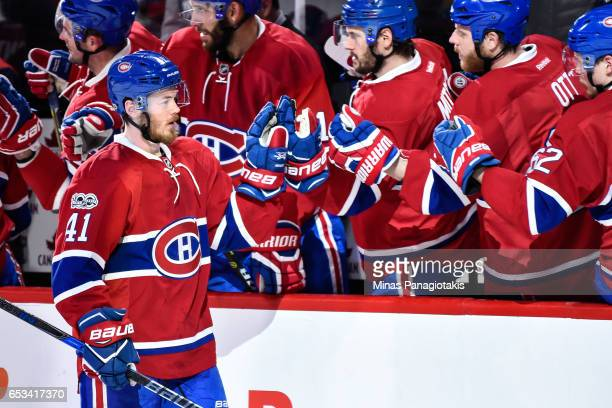 Paul Byron of the Montreal Canadiens celebrates his goal in the third period with teammates on the bench during the NHL game against the Chicago...