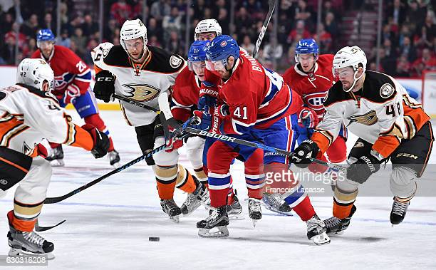Paul Byron of the Montreal Canadiens controls the puck against Colby Robak of the Anaheim Ducks in the NHL game at the Bell Centre on December 20...