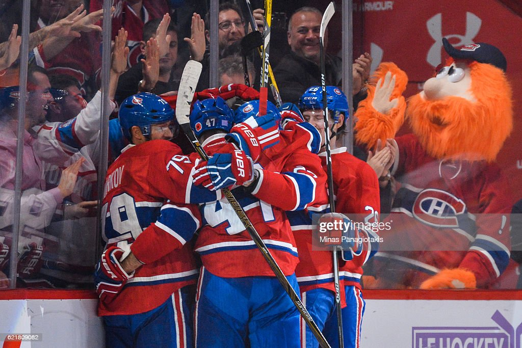 Paul Byron #41 of the Montreal Canadiens is smothered by his teammates as they celebrate his third period goal during the NHL game against the Boston Bruins at the Bell Centre on November 8, 2016 in Montreal, Quebec, Canada. The Montreal Canadiens defeated the Boston Bruins 3-2.