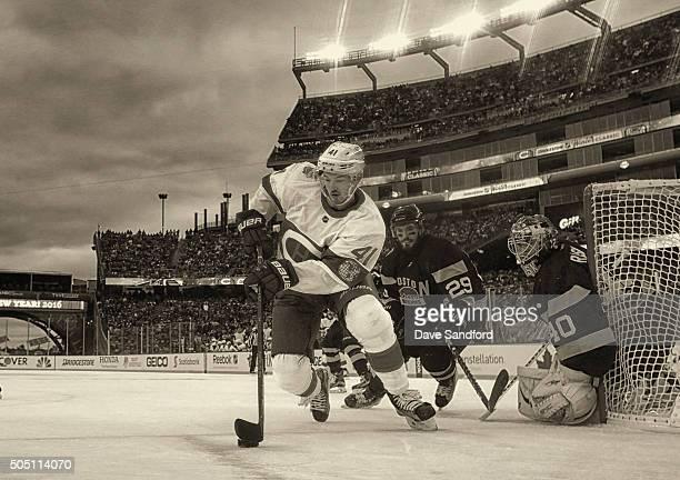 Paul Byron of the Montreal Canadiens plays against goaltender Tuukka Rask and Landon Ferraro of the Boston Bruins during the 2016 Bridgestone NHL...