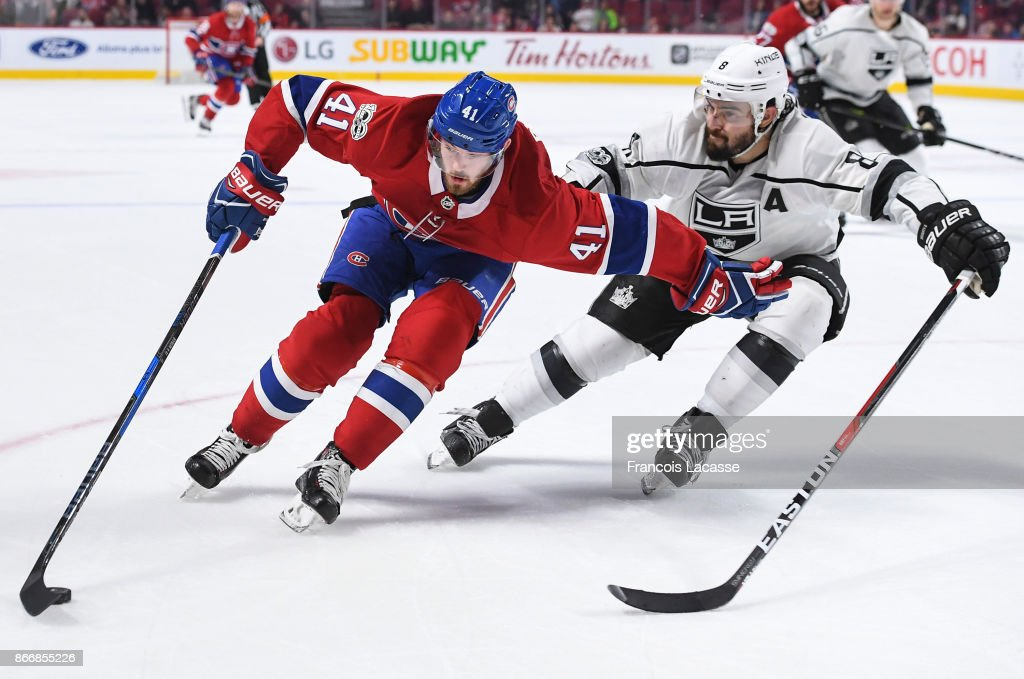 Paul Byron #41 of the Montreal Canadiens protects the puck while being Challenged by Drew Doughty #8 of the Los Angeles Kings in the NHL game at the Bell Centre on October 26, 2017 in Montreal, Quebec, Canada.