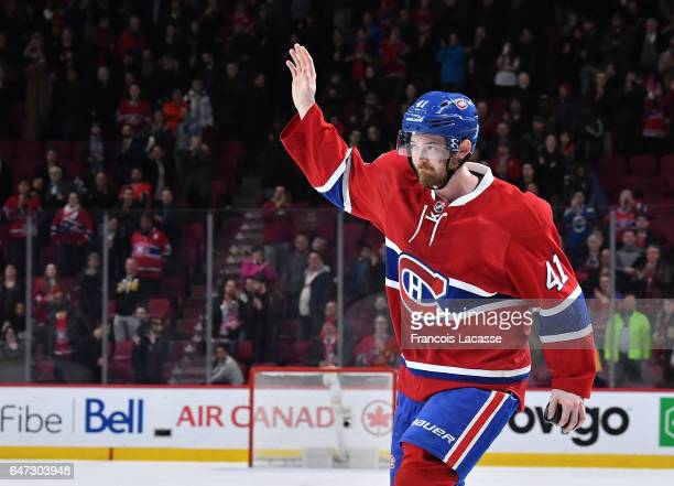 Paul Byron of the Montreal Canadiens salutes the crowd after being named the first star of the game against the Nashville Predators in the NHL game...