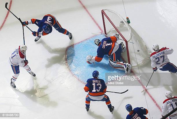 Paul Byron of the Montreal Canadiens scores a goal against Thomas Greiss of the New York Islanders at the Barclays Center on October 26 2016 in...