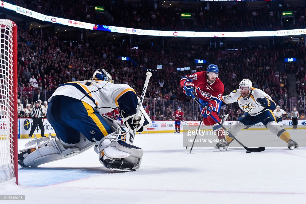 Paul Byron #41 of the Montreal Canadiens skates the puck past Matt Irwin #52 of the Nashville Predators and ended up scoring the game-winning goal on goaltender Pekka Rinne #35 of the Nashville Predators late in the third period during the NHL match at the Bell Centre on March 2, 2017 in Montreal, Quebec, Canada. The Montreal Canadiens defeated the Nashville Predators 2-1.
