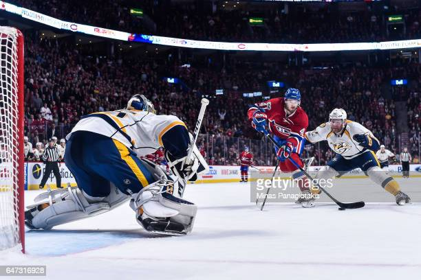 Paul Byron of the Montreal Canadiens skates the puck past Matt Irwin of the Nashville Predators and ended up scoring the gamewinning goal on...