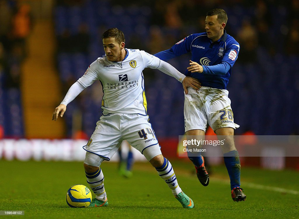 Paul Caddis of Birmingham City tackles Ross McCormack of Leeds United during the FA Cup with Budweiser Third Round Replay match between Birmingham City and Leeds United at St Andrews on January 15, 2013 in Birmingham, England.