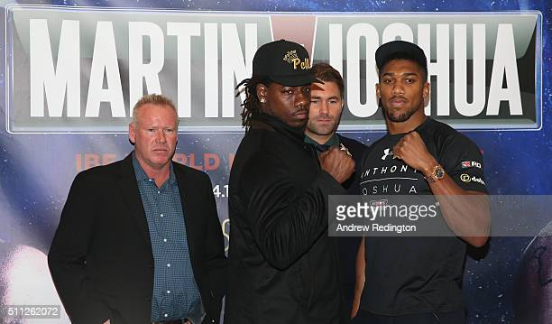 Paul Cain Charles Martin of the USA promoter Eddie Hearn and Anthony Joshua of England are pictured together during the Anthony Joshua and Charles...