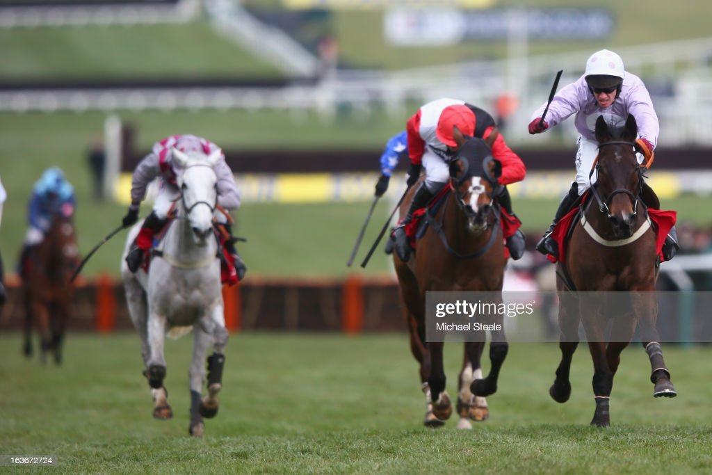Paul Carberry (R) riding Solwhit on his way to winning the Ladbrokes World Hurdle race from Daryl Jacob (2R) riding Celestial Halo on St Patrick's Thursday at Cheltenham Racecourse on March 14, 2013 in Cheltenham, England.
