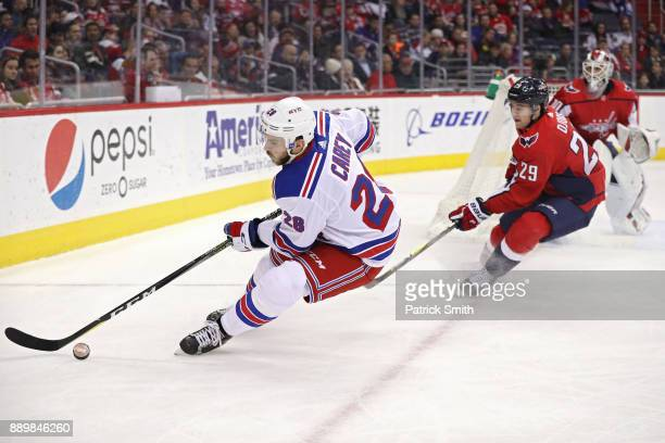 Paul Carey of the New York Rangers skates past Christian Djoos of the Washington Capitals during the first period at Capital One Arena on December 08...