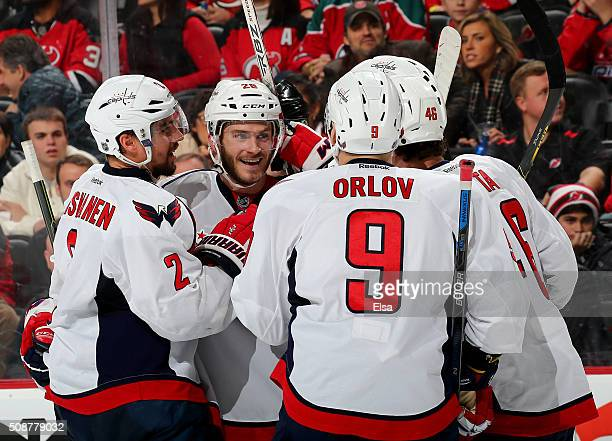 Paul Carey of the Washington Capitals celebrates his goal with teammates Matt NiskanenDmitry Orlov and Michael Latta in the third period against the...