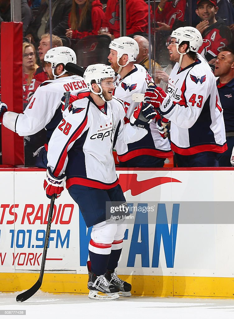 Paul Carey #28 of the Washington Capitals is congratulated by his teammates after scoring a goal against the New Jersey Devils at the Prudential Center on February 6, 2016 in Newark, New Jersey.
