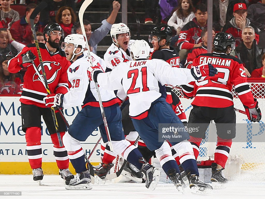 Paul Carey #28 of the Washington Capitals reacts with his teammates after scoring a goal against the New Jersey Devils at the Prudential Center on February 6, 2016 in Newark, New Jersey.