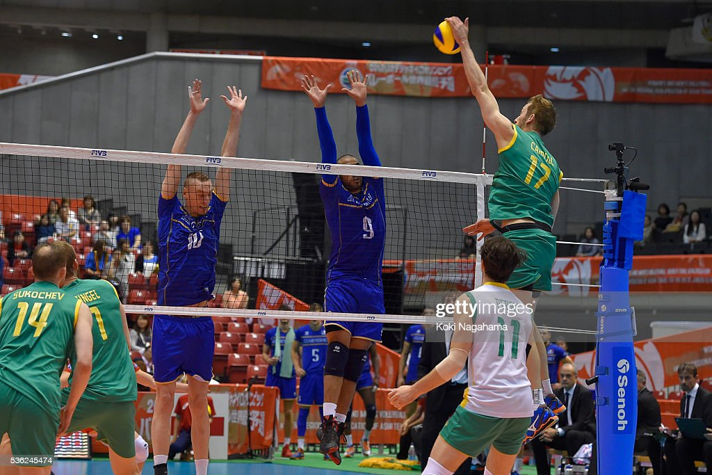 Paul Carroll #17 of Australia spikes the ball during the Men's World Olympic Qualification game between France and Australia at Tokyo Metropolitan Gymnasium on June 1, 2016 in Tokyo, Japan.