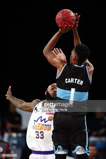 Paul Carter of the Breakers takes a three pointer over Josh Powell of the Kings during the round 15 NBL match between the New Zealand Breakers and...