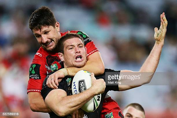 Paul Carter of the Rabbitohs is tackled high by Gareth Widdop of the Dragons during the round 11 NRL match between the South Sydney Rabbitohs and the...