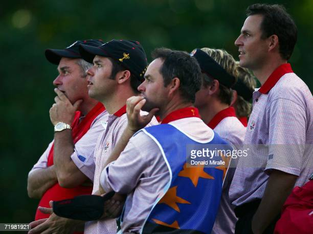 Paul Casey and David Howell of Europe watch the action with their caddies during the singles matches on the final day of the 2006 Ryder Cup at The K...