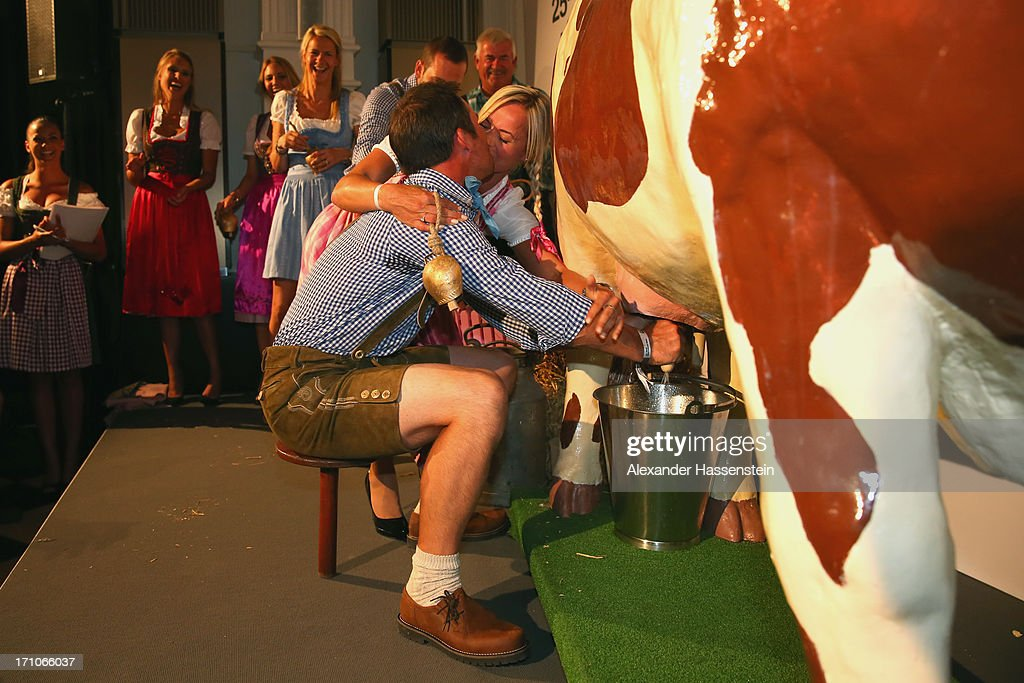 <a gi-track='captionPersonalityLinkClicked' href=/galleries/search?phrase=Paul+Casey&family=editorial&specificpeople=198895 ng-click='$event.stopPropagation()'>Paul Casey</a> competes with Pollyanna Woodward in a cow milking fun competition during the BMW International Open 25th Anniversary Party at Rilano No.6 Lenbach Palais on June 21, 2013 in Munich, Germany.