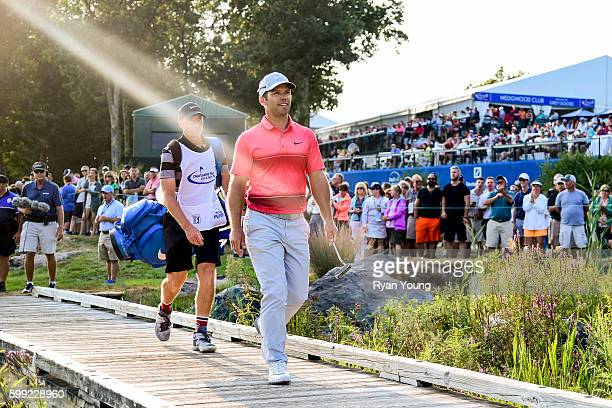 Paul Casey crosses the bridge on the 18th hole during the third round of the Deutsche Bank Championship at TPC Boston on September 4 2016 in Norton...