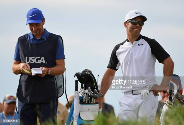 Paul Casey of England and caddie John McLaren prepare to play his shot from the tenth tee during the second round of the 2017 US Open at Erin Hills...