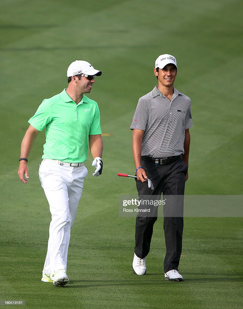 Paul Casey of England and Matteo Manassero of Itlay share a joke during the first round of the Omega Dubai Desert Classic on January 31, 2013 in Dubai, United Arab Emirates.