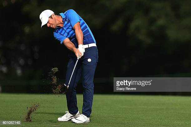 Paul Casey of England hits his approach shot on the 16th hole during a continuation of the first round of the BMW Championship at Crooked Stick Golf...