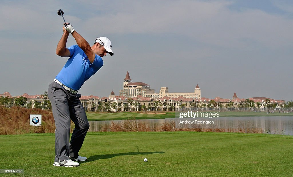 Paul Casey of England hits his tee-shot on the ninth hole during the final round of the BMW Masters at Lake Malaren Golf Club on October 27, 2013 in Shanghai, China.