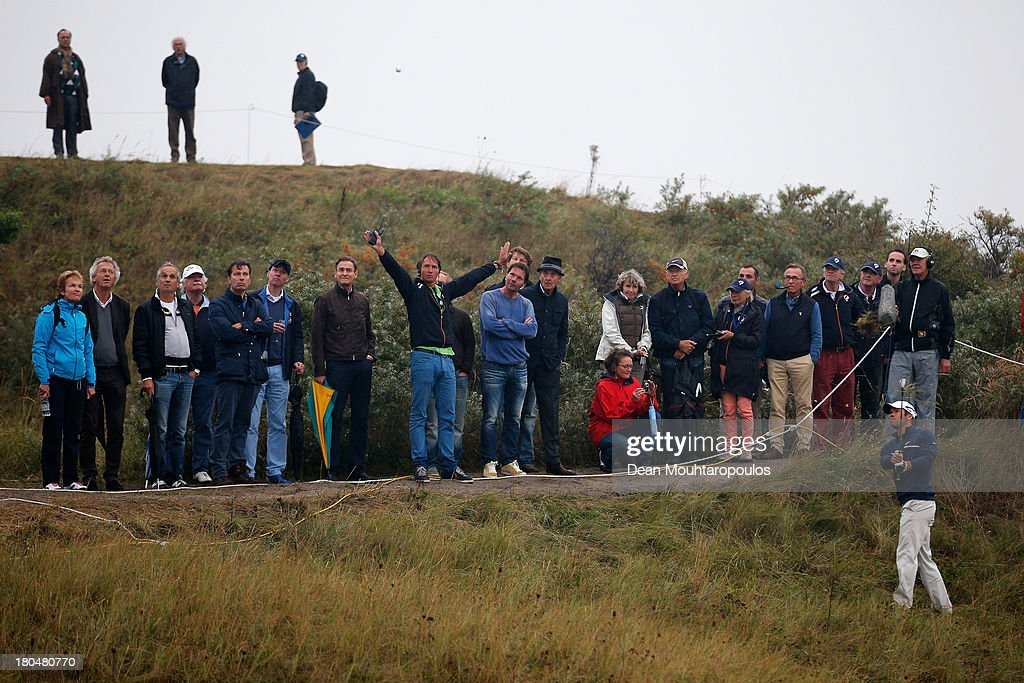 Paul Casey (bottom right of frame) of England hits his third shot on the 18th hole during Day 2 of the KLM Open at Kennemer G & CC on September 13, 2013 in Zandvoort, Netherlands.