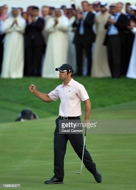 Paul Casey of England holes the winning putt on the 18th green during the final round of the 2011 Volvo Champions held at the Royal Golf Club on...