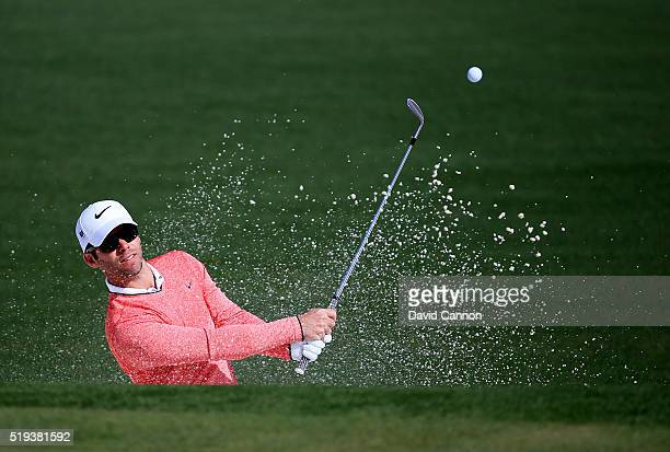 Paul Casey of England plays a shot from a bunker during a practice round prior to the start of the 2016 Masters Tournament at Augusta National Golf...