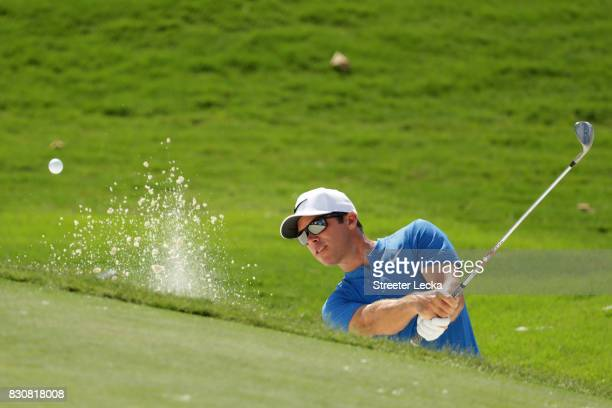 Paul Casey of England plays a shot from a bunker on the eighth hole during the third round of the 2017 PGA Championship at Quail Hollow Club on...