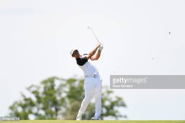 Paul Casey of England plays his second shot on the eighth hole during the second round of the 2017 US Open at Erin Hills on June 16 2017 in Hartford...