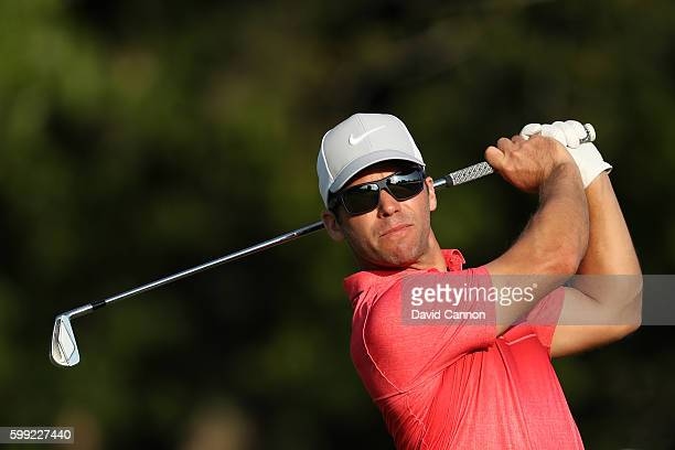 Paul Casey of England plays his shot from the 17th tee during the third round of the Deutsche Bank Championship at TPC Boston on September 4 2016 in...