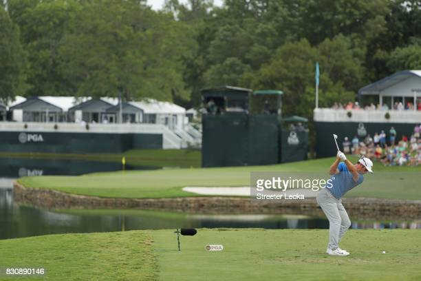 Paul Casey of England plays his shot from the 17th tee during the third round of the 2017 PGA Championship at Quail Hollow Club on August 12 2017 in...