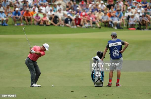 Paul Casey of England plays his shot on the eighth green during the second round of the 2017 PGA Championship at Quail Hollow Club on August 11 2017...