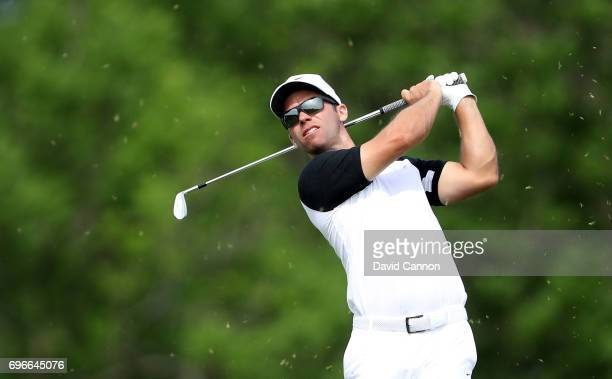 Paul Casey of England plays his tee shot on the par 3 16th hole during the second round of the 117th US Open Championship at Erin Hills on June 16...