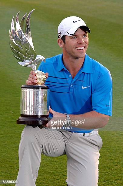 Paul Casey of England poses with his trophy after winning the Abu Dhabi Golf Championship in the Gulf emirate on January 18 2009 Newlymarried Casey...