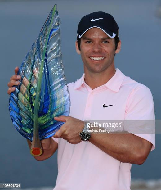 Paul Casey of England poses with the trophy after winning the Volvo Golf Champions at The Royal Golf Club on January 30 2011 in Bahrain Bahrain