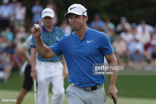 Paul Casey of England reacts to his putt on the eighth green during the third round of the 2017 PGA Championship at Quail Hollow Club on August 12...