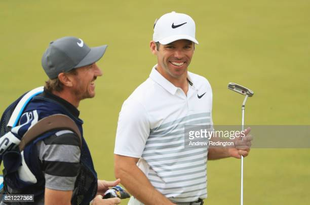 Paul Casey of England smiles with his caddie John McLaren on the 18th green during the final round of the 146th Open Championship at Royal Birkdale...