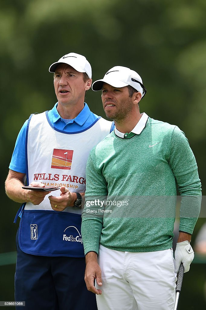<a gi-track='captionPersonalityLinkClicked' href=/galleries/search?phrase=Paul+Casey&family=editorial&specificpeople=198895 ng-click='$event.stopPropagation()'>Paul Casey</a> of England speaks with his caddie on the 13th tee during the second round of the Wells Fargo Championship at Quail Hollow Club on May 6, 2016 in Charlotte, North Carolina.