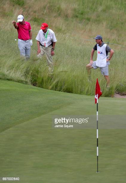 Paul Casey of England takes a drop on the third hole during the third round of the 2017 US Open at Erin Hills on June 17 2017 in Hartford Wisconsin