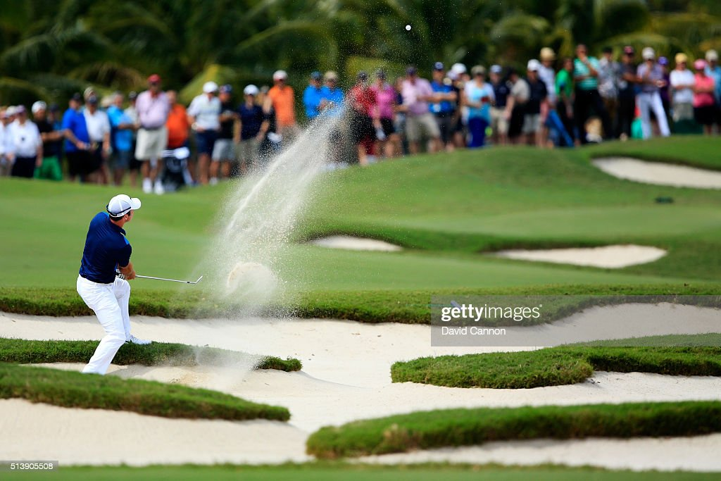 Paul Casey of England takes his third shot on the first hole during the third round of the World Golf ChampionshipsCadillac Championship at Trump...