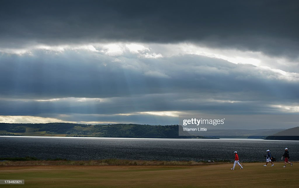 <a gi-track='captionPersonalityLinkClicked' href=/galleries/search?phrase=Paul+Casey&family=editorial&specificpeople=198895 ng-click='$event.stopPropagation()'>Paul Casey</a> of England walks down the 18th hole during the final round of the Aberdeen Asset Management Scottish Open at Castle Stuart Golf Links on July 14, 2013 in Inverness, Scotland.