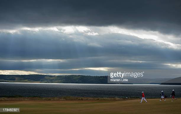 Paul Casey of England walks down the 18th hole during the final round of the Aberdeen Asset Management Scottish Open at Castle Stuart Golf Links on...