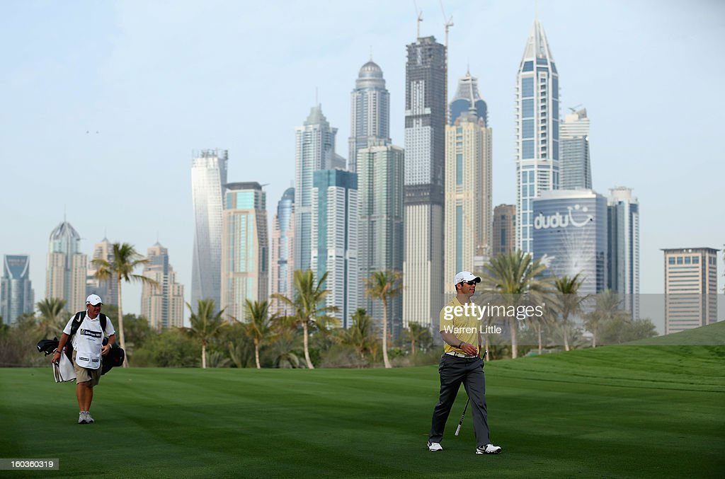 Paul Casey of England walks with his caddie Dominic Bott during the pro-am of the Omega Dubai Desert Classic at Emirates Golf Club on January 30, 2013 in Dubai, United Arab Emirates.